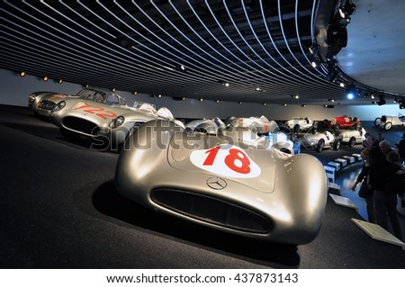 Stuttgart, Germany - April 22, 2014: Interior of a modern museum of Mercedes cars. Exposition of racing cars on a dark background.