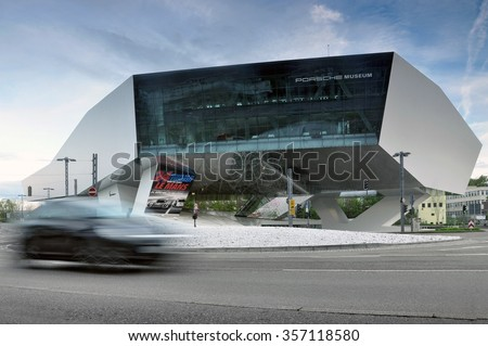 STUTTGART, GERMANY - APRIL 21TH, 2014: Porsche museum building and moving car in the foreground. Zuffenhausen, Stuttgart, Germany on April 21, 2014. - stock photo