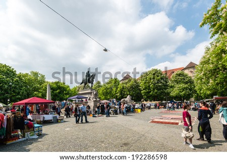STUTTGART, GERMANY - APRIL 26, 2014: Visitors of the famous Stuttgart flea market (very famous, happening every Saturday) on Karlsplatz in the city center on April, 26, 2014 in Stuttgart, Germany. - stock photo