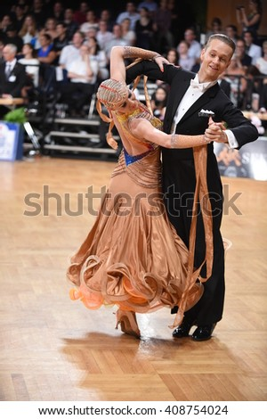 Stuttgart, Germany - August 15, 2015: An unidentified dance couple in a dance pose during Grand Slam Standart at German Open Championship, on August 16, in Stuttgart, Germany