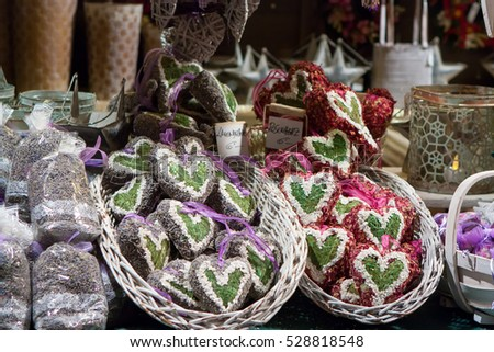 STUTTGART, GERMANY - DECEMBER 3, 2016: Heart-shaped Christmas ornaments filled with lavender and rose petals in a kiosk at Christmas market (Weihnachtsmarkt) on December 3, 2016 in Stuttgart, Germany.