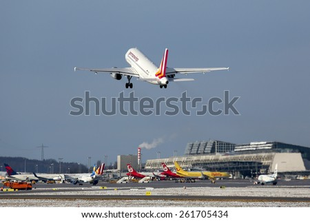 STUTTGART, GERMANY - JANUARY 31:  A Germanwings Airbus A319 taking off on January 31, 2015 in Stuttgart. Germanwings is a German low-cost airline which is owned by Lufthansa. - stock photo