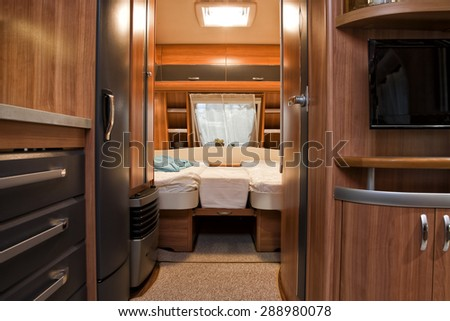 Stuttgart, Germany, 17 January 2015: Bedroom of motorhome, caravanning, motoring and tourism trade. - stock photo
