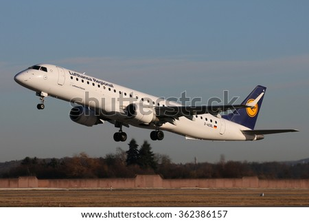 Stuttgart/Germany January 14, 2016: This Lufthansa Cityline Embraer 195 is taking off to the City of Munich