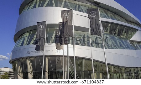 STUTTGART, GERMANY - Juli 03, 2017: Facade of the  Mercedes Benz museum in Stuttgart with trademark flags in the foreground