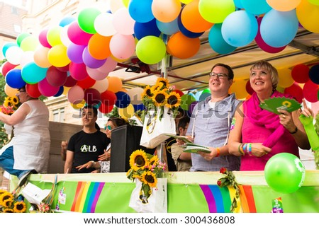 STUTTGART, GERMANY - JULY 25, 2015: Claudia Roth and Cem Oezdemir of the German Green Party are participating on the Christopher Street Day 2015 in Stuttgart. - stock photo