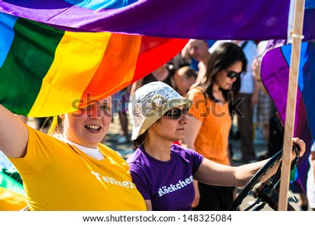 STUTTGART, GERMANY - JULY 27, 2013:Participants celebrating Christopher Street Day on July 27, 2013 in Stuttgart, Germany.The gay & lesbian pride festival is happening for the 17th time in Stuttgart