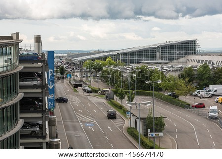 Stuttgart, Germany - June 25, 2016: Parking Garages , roads and passage ways and the main building of the airport in Stuttgart, Germany. - stock photo