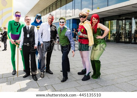 Stuttgart, Germany - June 25, 2016: Several cosplayers are posing during the Comic Con Germany event in Stuttgart in front of the exhibition hall on public ground.  - stock photo