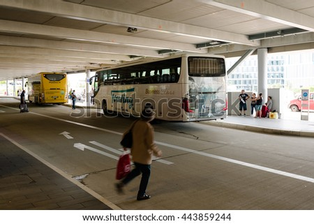 Stuttgart, Germany - June 25, 2016: Two long distance busses in the new Stuttgart Central Bus Station at the airport. Since the monopoly of the Deutsche Bahn (German railroads) ended in 2013, a lot of - stock photo