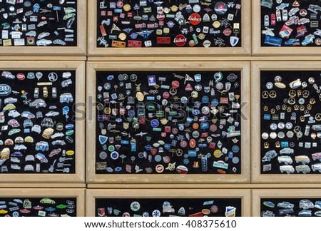 "STUTTGART, GERMANY - MARCH 18, 2016: Background of lapel pins with the logos of well-known automobile firms (modern and retro). Europe's greatest classic car exhibition ""RETRO CLASSICS"" - stock photo"