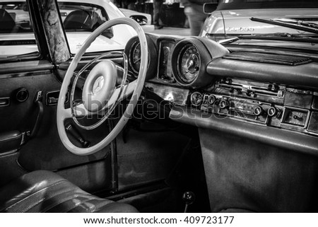 "STUTTGART, GERMANY - MARCH 18, 2016: Cabin of full-size luxury car Mercedes-Benz 280 SE 3.5 Coupe (W111), 1970. Black and white. Europe's greatest classic car exhibition ""RETRO CLASSICS"""