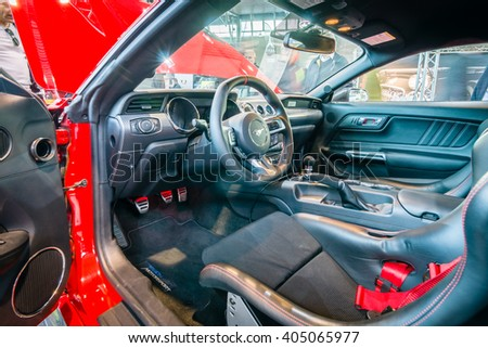 "STUTTGART, GERMANY - MARCH 17, 2016: Cabin of pony car Ford Mustang GT fastback coupe (sixth generation), 2015. HDRi. Europe's greatest classic car exhibition ""RETRO CLASSICS"""