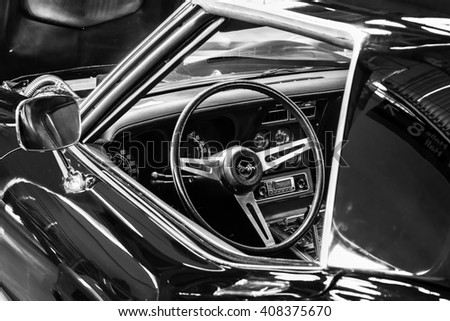 "STUTTGART, GERMANY - MARCH 18, 2016: Cabin of sports car Chevrolet Corvette (C3) Stingray Coupe. Black and white. Europe's greatest classic car exhibition ""RETRO CLASSICS"" - stock photo"