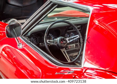 "STUTTGART, GERMANY - MARCH 18, 2016: Cabin of sports car Chevrolet Corvette (C3) Stingray Coupe. Europe's greatest classic car exhibition ""RETRO CLASSICS"" - stock photo"