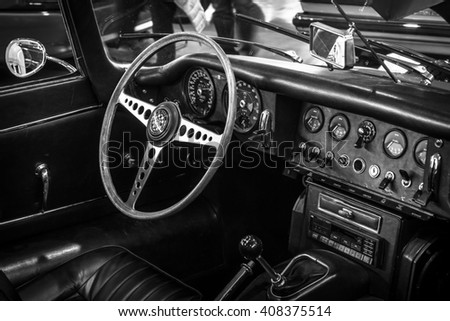 "STUTTGART, GERMANY - MARCH 18, 2016: Cabin of sports car Jaguar E-Type 4.2 Serie I roadster, 1967. Black and white. Europe's greatest classic car exhibition ""RETRO CLASSICS"""