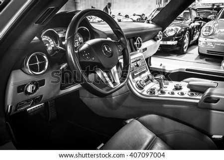 "STUTTGART, GERMANY - MARCH 18, 2016: Cabin of supercar Mercedes-Benz SLS AMG 6,3 Coupe, 2010. Black and white. Europe's greatest classic car exhibition ""RETRO CLASSICS"""