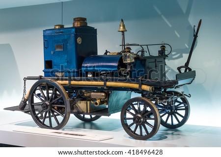 STUTTGART, GERMANY- MARCH 19, 2016: Daimler motorized fire-fighting pump (Daimler Motor-Feuerspritze), 1892. Mercedes-Benz Museum. - stock photo