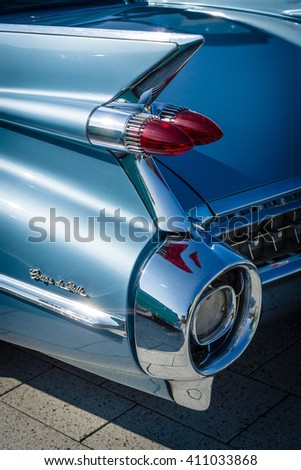"""STUTTGART, GERMANY - MARCH 18, 2016: Detail of the rear wing and brake lights of the car Cadillac Coupe de Ville, 1959. Europe's greatest classic car exhibition """"RETRO CLASSICS"""" - stock photo"""