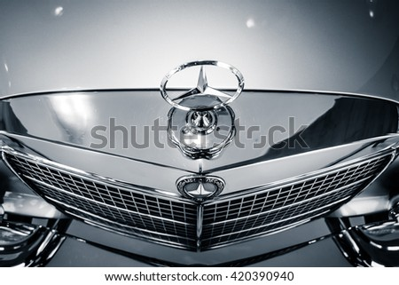 STUTTGART, GERMANY- MARCH 19, 2016: Fragment of full-size luxury car Mercedes-Benz 300 SEL 6.3, 1972. Black and white. Mercedes-Benz Museum. - stock photo