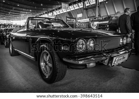 "STUTTGART, GERMANY - MARCH 17, 2016: Grand tourer car Jensen Interceptor MkIII Convertible, 1974. Black and white. Europe's greatest classic car exhibition ""RETRO CLASSICS"" - stock photo"