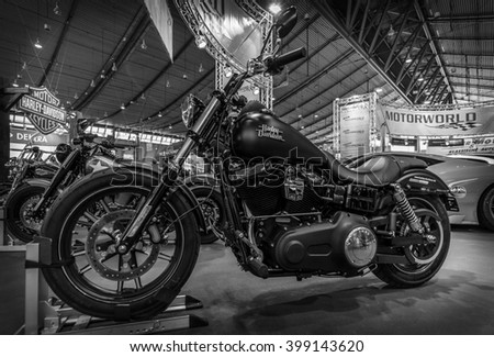 """STUTTGART, GERMANY - MARCH 17, 2016: Motorcycle Harley-Davidson Dyna Street Bob, 2016. Black and white. Europe's greatest classic car exhibition """"RETRO CLASSICS"""" - stock photo"""