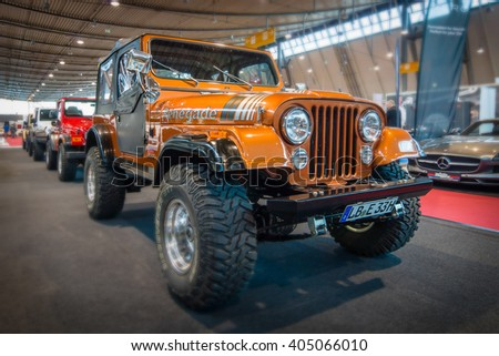 "STUTTGART, GERMANY - MARCH 17, 2016: Off-road Jeep Wrangler Renegade, 1994.Tilt-Shift. Europe's greatest classic car exhibition ""RETRO CLASSICS"" - stock photo"