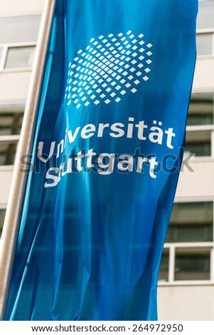 STUTTGART, GERMANY - MARCH 21, 2015: The flag in front of the University of Stuttgart is moving in the wind on March 28, 2015 in Stuttgart, Germany. - stock photo