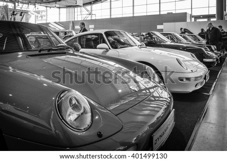 """STUTTGART, GERMANY - MARCH 17, 2016: Various models of Porsche sports cars stand in a row. Black and white. Europe's greatest classic car exhibition """"RETRO CLASSICS"""" - stock photo"""