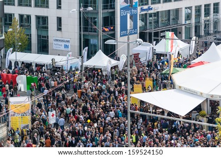 STUTTGART, GERMANY - OCTOBER 3, 2013: Almost 100.000 people celebrating German Unity Day all around Stuttgart, the city nominated for this years festivities on October 3, 2013 in Stuttgart, Germany