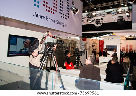 "STUTTGART - MARCH 18: Booth of Boerse (Stock Exchange) Stuttgart with TV studio to record financial news at ""Invest"" exhibition at the Trade Fair on March 18, 2011 in Stuttgart , Germany."