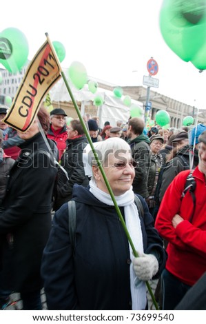 STUTTGART - MARCH 19: 60K people protest against the S21 rail project on March 19, 2011 in Stuttgart, Germany. S21 station is one of the most expensive and controversial railway projects ever. - stock photo