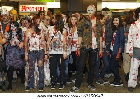 STUTTGART - OCTOBER 26: The Annual Zombie Walk Stuttgart People dress as Zombies and scare people in Stuttgart City. October 26, 2013 in Stuttgart, Germany.