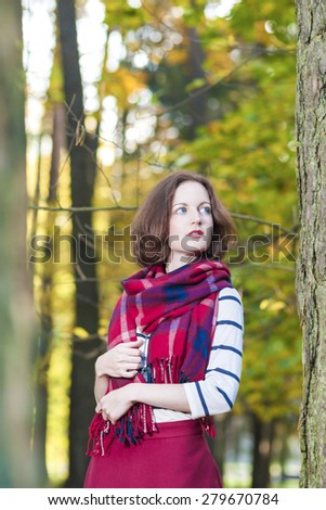 Style and Fashion Concept and Ideas: Young Caucasian Female Brunette Woman in Made to Measure Clothing Standing in Autumn Forest Outdoors. Vertical Image Orientation - stock photo