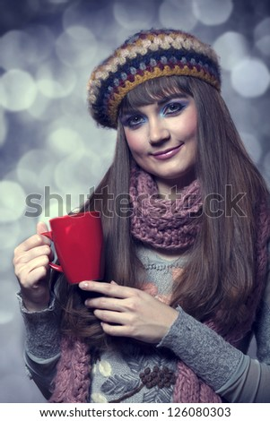Style girl in scarf with cup