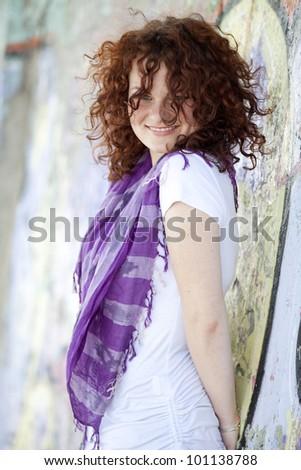 Style girl near graffiti wall. - stock photo