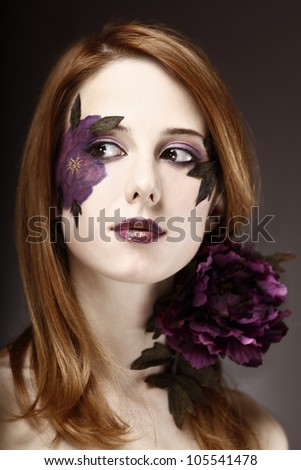 Style girl with makeup and violet flower. - stock photo