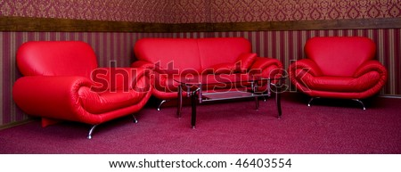 style interior room with red sofa and glass table