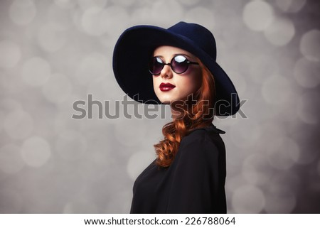 Style redhead women with sunglasses. - stock photo