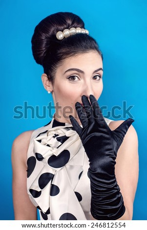 Styled Surprised Woman with Retro Hair Style - stock photo