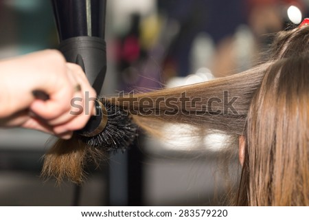 styling hair dryer in a beauty salon
