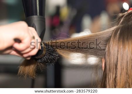 styling hair dryer in a beauty salon - stock photo