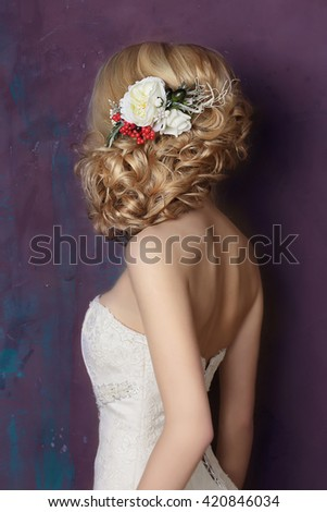 Styling hair with flowers. Portrait of the bride.  - stock photo