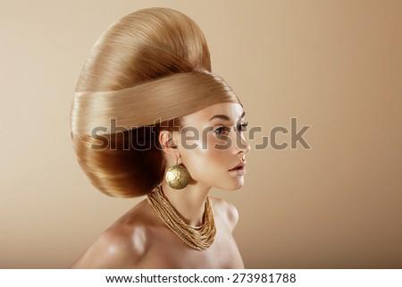Styling. Profile of Glamorous Woman with Golden Hairdo - stock photo