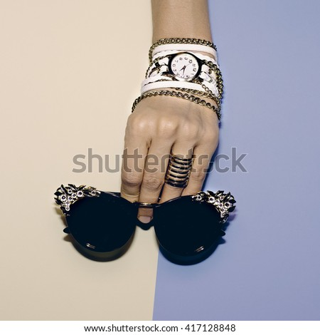 Stylish Accessories. Watches and Sunglasses. Luxury trend. - stock photo