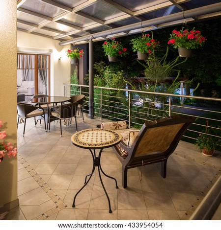 Stylish and illuminated terrace of the house