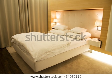 Stylish and trendy bedroom in white and beige - stock photo