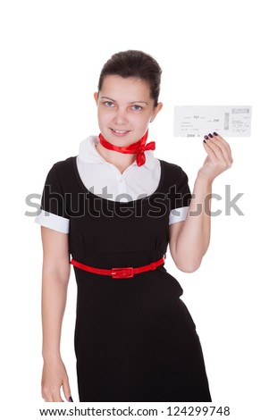 Stylish attractive flight attendant holding up an airline ticket in her hand isolated on white - stock photo