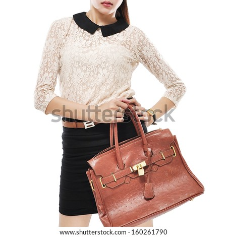 Stylish beautiful woman with bag, isolated on white background - stock photo