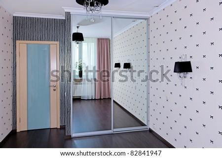 Stylish bedroom interior, door view - stock photo